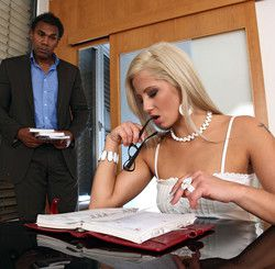 Gorgeous blonde examining a tax return..
