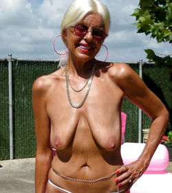 White haired amateur granny posing in..