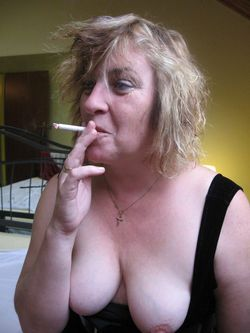 Cheerful mature whore gets her breasts..
