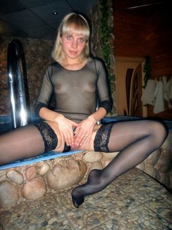 Leggy fifty-year-old housewife puts a..