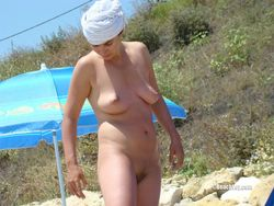 Fame nudist voyeur photos on the beach