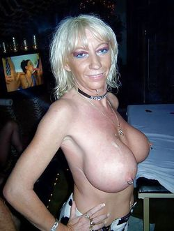 Perky mature with pierced nipples..
