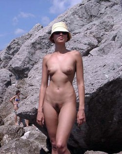 Crimean girl naked on public beach..