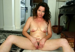 Blue eyed mom rubs her hairy twat