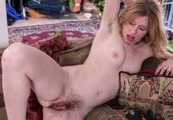 Petite MILF opens her hairy snatch