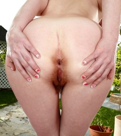 Marie Mccray demonstrating hairy pussy..