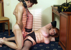 Stockinged mature enjoys her young slave
