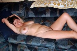 Naked housewife caresses herself with..