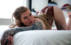 Charming tattooed lioness naked pics