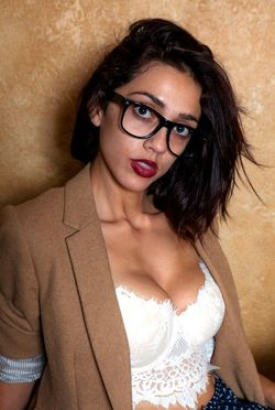 Nerdy skinny girl in glasses..