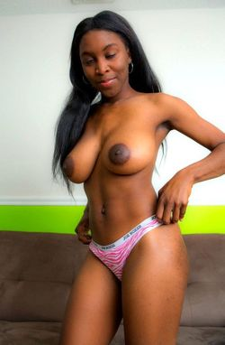 Sexy ebony hottie undressing to reveal..